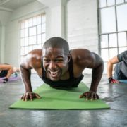 People doing push ups during workout class.