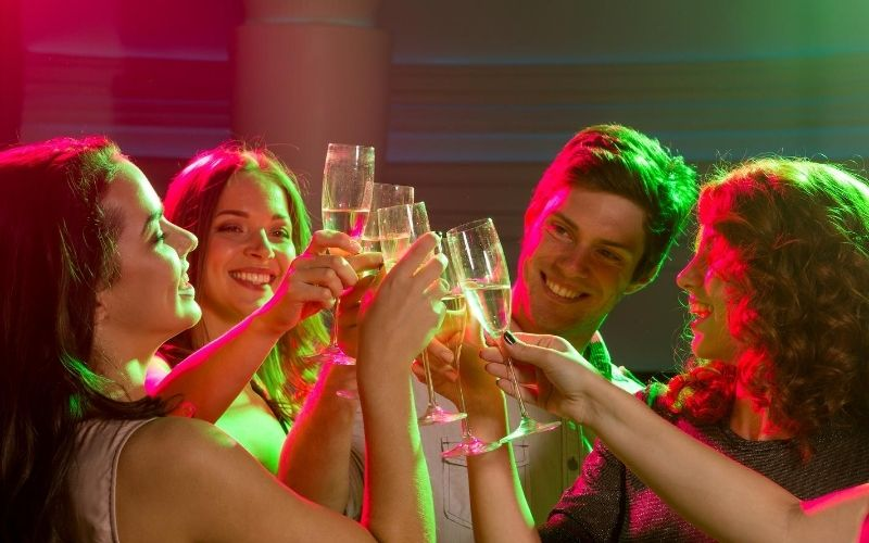 Friends cheers-ing champagne at a party.