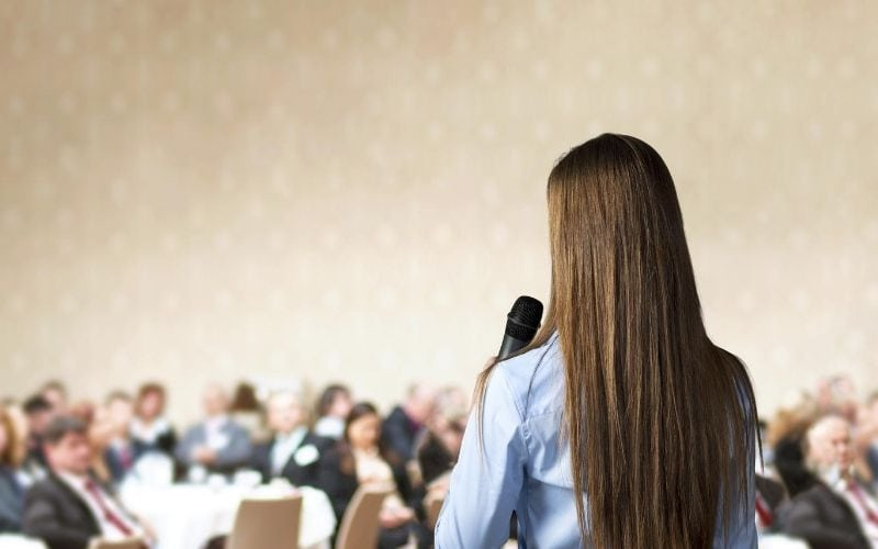 Woman speaking at conference.