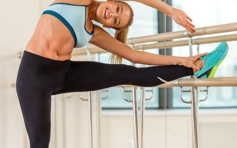 Woman doing barre workout.