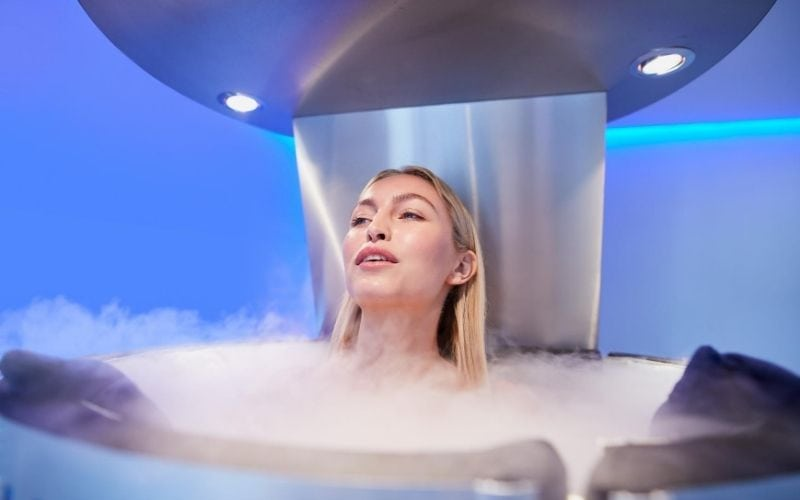 Woman in cryotherapy machine.