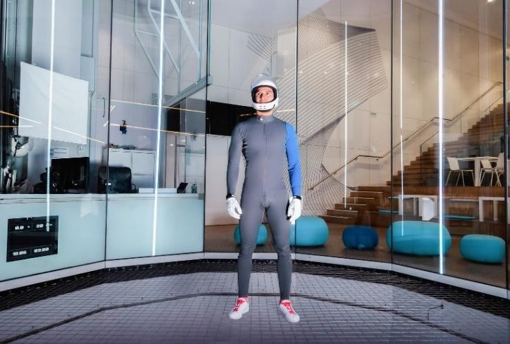 Man in indoor skydiving facility.