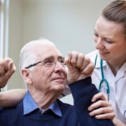 Man working with doctor after stroke.