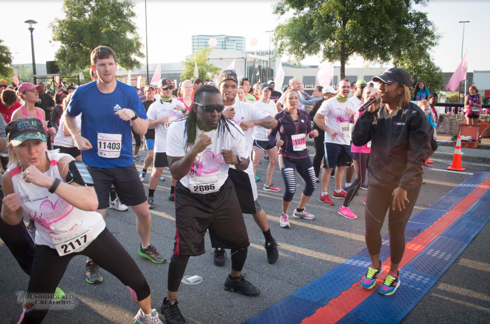 Madison James leads the 2016 Komen Race for the Cure warm up.