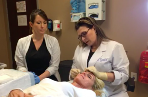 Dr. Whitaker and Samantha Shepard, RN, administer the Babytox serum to Candace.