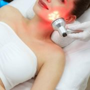 Woman getting red light therapy on her face.