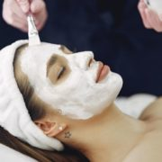 Woman getting a mask (white) during facial.