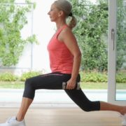 Older woman doing lunges.