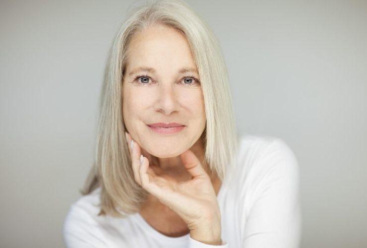 Older woman showing her beautiful, healthy skin.