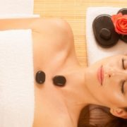 Woman receiving Pure Bliss facial with hot stones.
