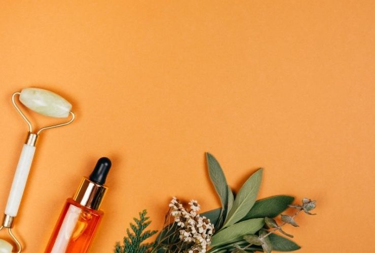 Natural skin products on an orange background.