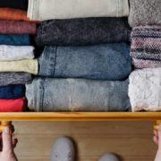 Open drawer full of organized clothing.