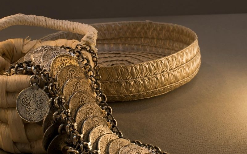 Coin jewelry and gold bracelet.