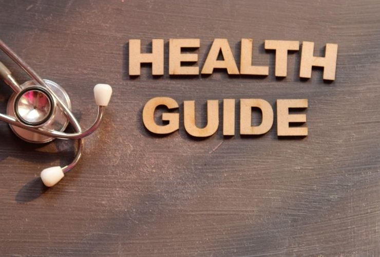 """Photo of stethoscope and """"Health Guide"""" in wood letters."""