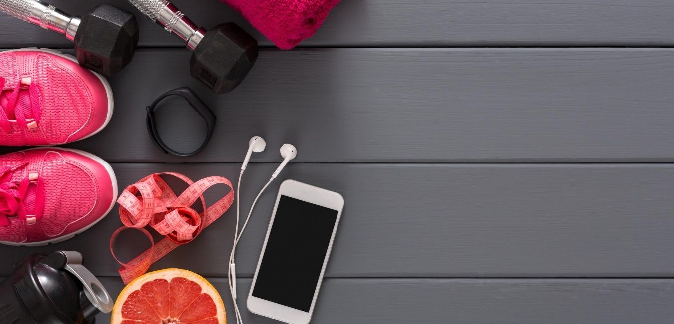 Pink workout equipment on grey table.