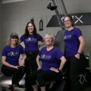Next Age Fitness instructors taking a group photo.