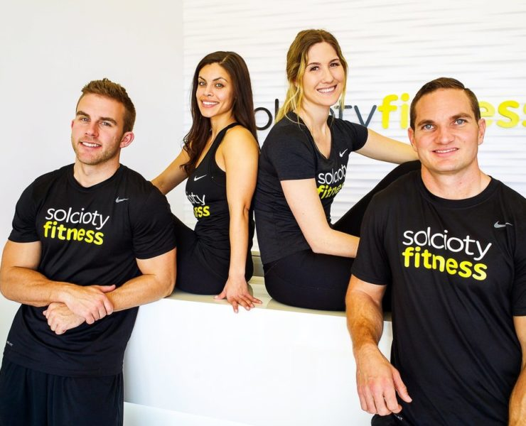 Solicity fitness instructors standing together for photo.