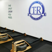Rowing equipment at Total Row Fitness gym.