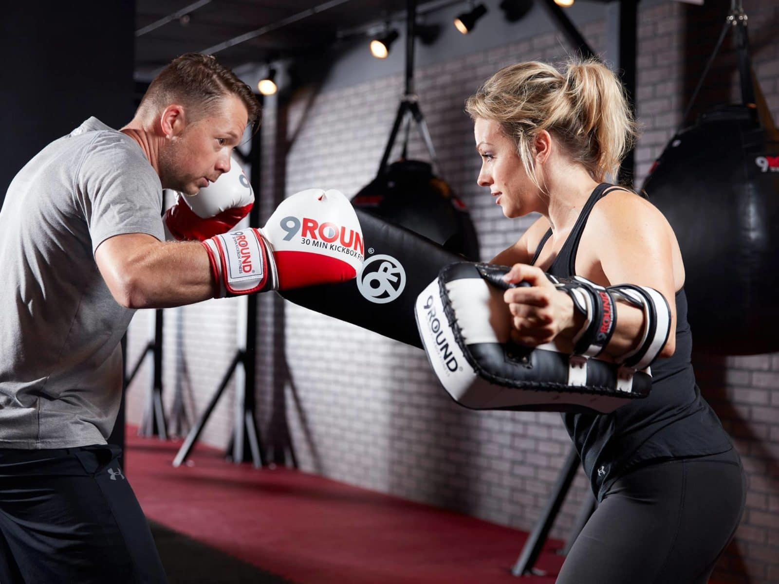 Instructor and student boxing at 9Round gym in Decatur, GA.