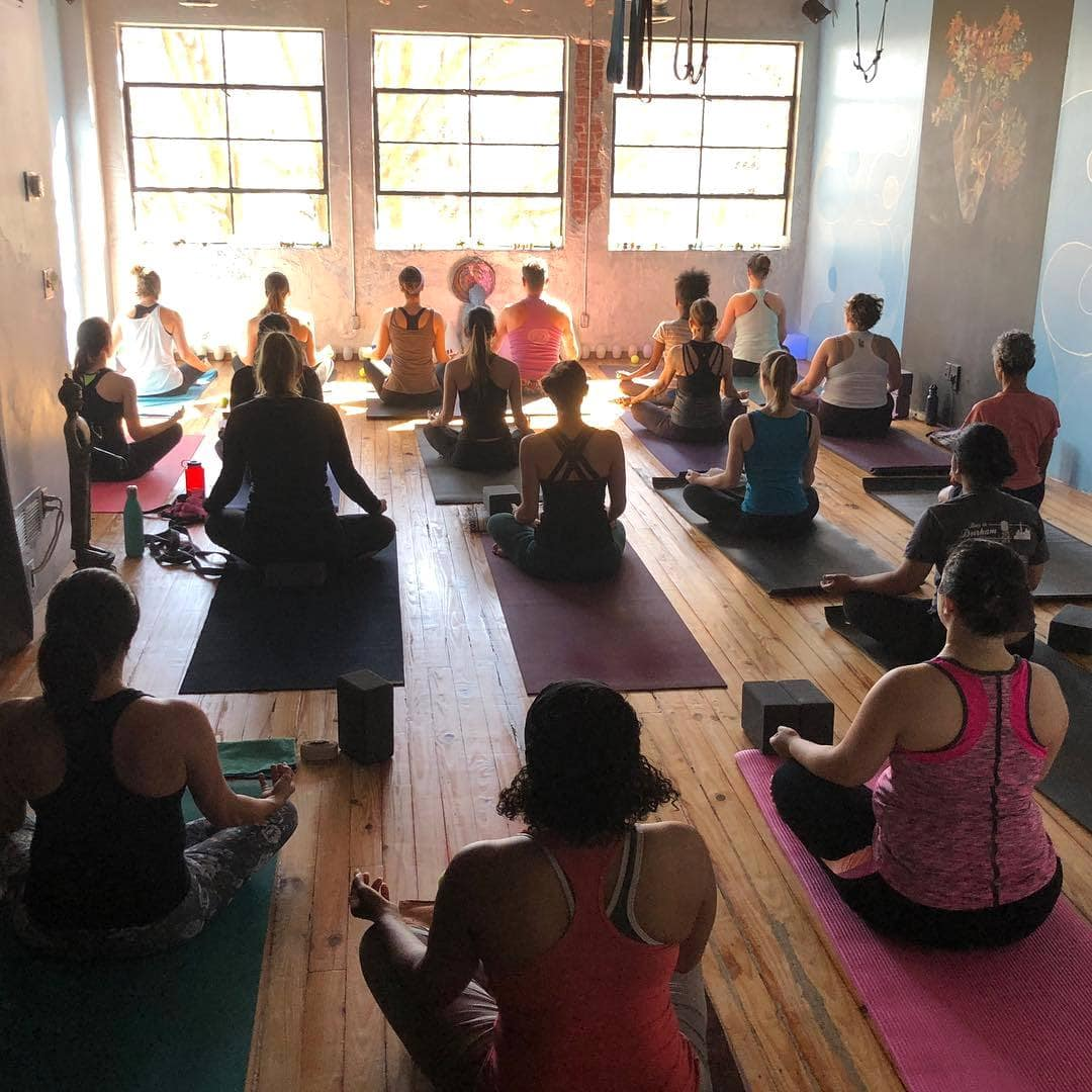 People meditating after a yoga class.