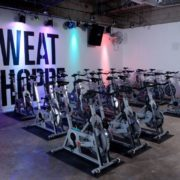 Cycling room with multicolored lights.