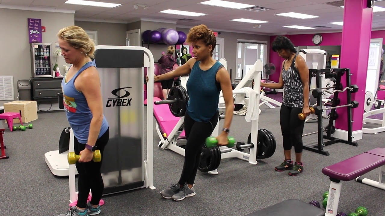 Women using workout equipment at Atlanta Fitness Diva's gym.