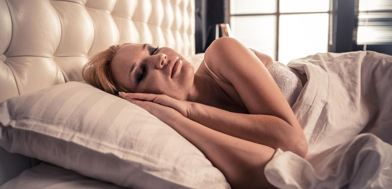 Woman in bed peacefully sleeping.