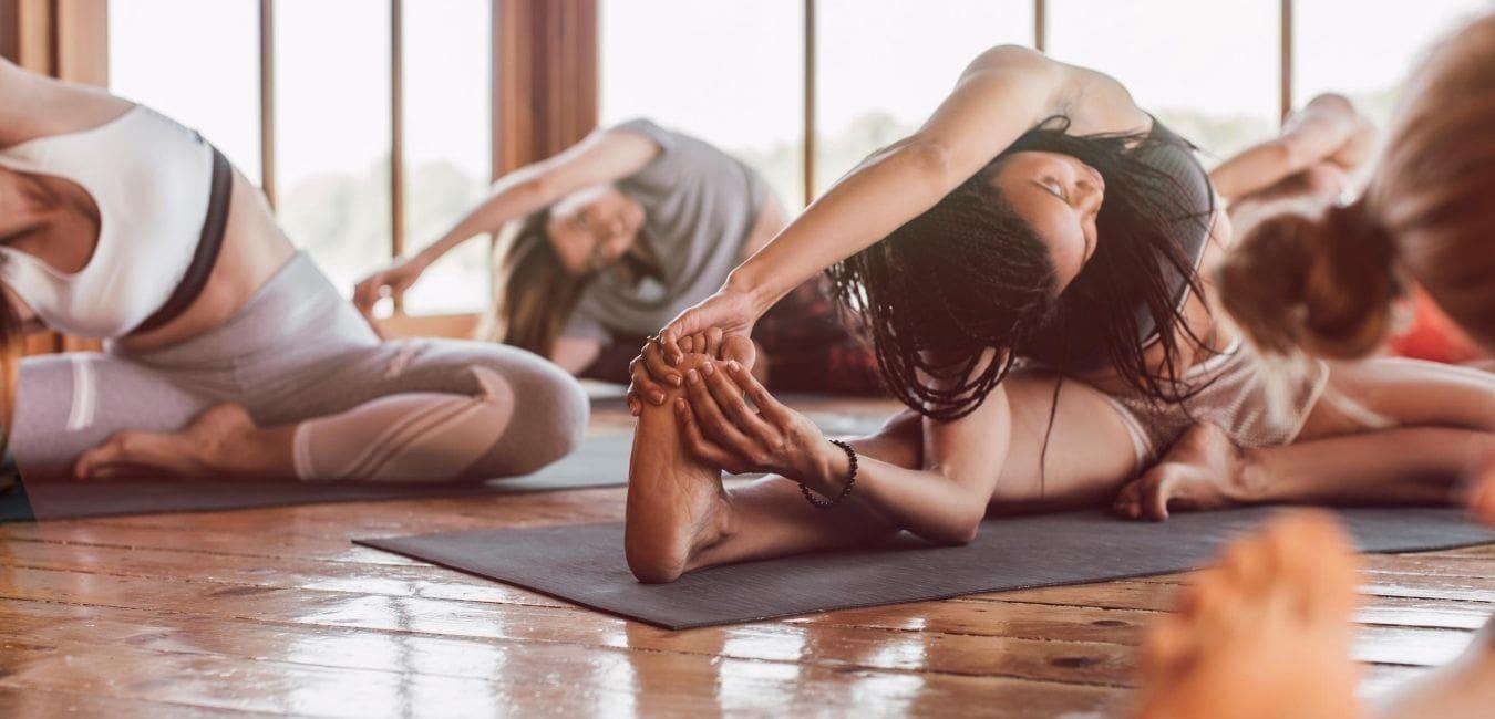 Women in yoga class doing a pose.