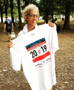 Laura with her 2019 Peachtree Road Race shirt.
