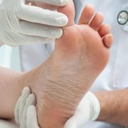 Doctor examining foot.