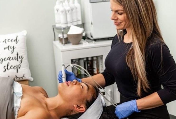 Woman giving a lady a facial at CentreSpring