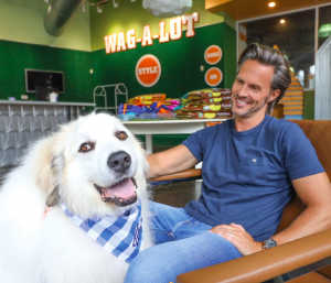 (L TO R): LARS AND HIS DOG DAD, WAG-A-LOT FOUNDER, CRAIG KOCH TAKE A LOAD OFF.