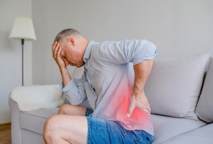 Man holding back in pain.
