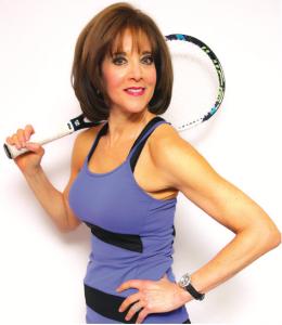 Audrey Schemer holding a tennis racket.