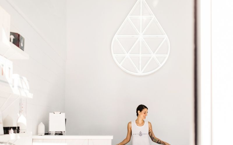 Receptionist in front of white background at HotBox Studio