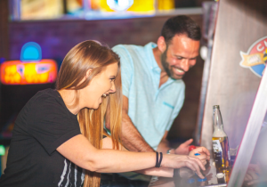 People playing an arcade game