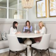 Three women sitting around a table at Eleanor's Place