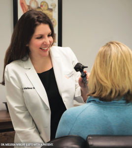 DR. MELISSA WIKOFF (LEFT) WITH A PATIENT.