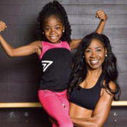 Jackie Madison holding her daughter of Glamour Girl Fitness