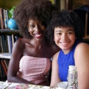 Rhian Sharp with her natural hair and her daughter