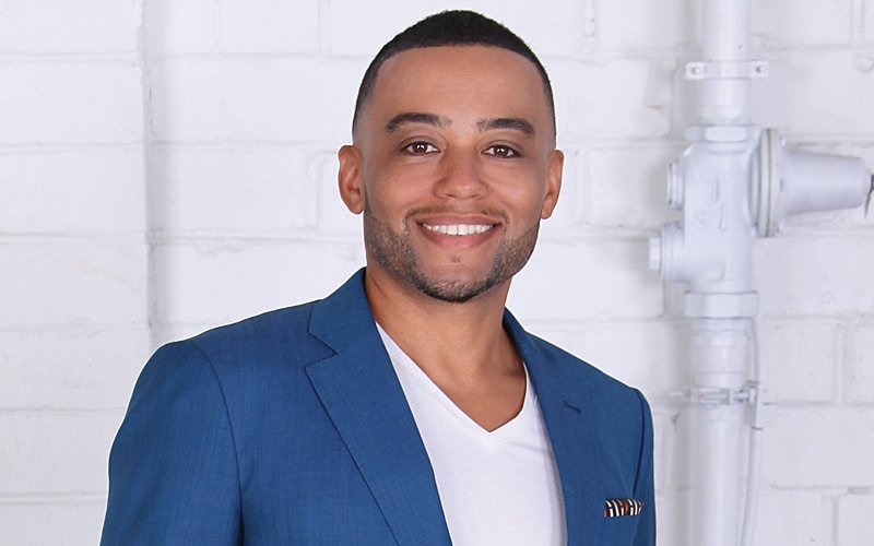 Handsome African American male in blue jack and white shirt