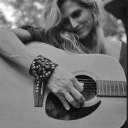 Michelle Hodgson playing guitar