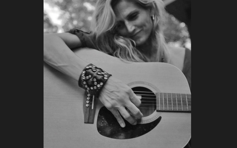 Michelle Hodgson playing guitar