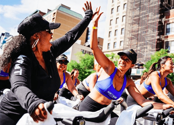 Movement Women on Stationary Bikes