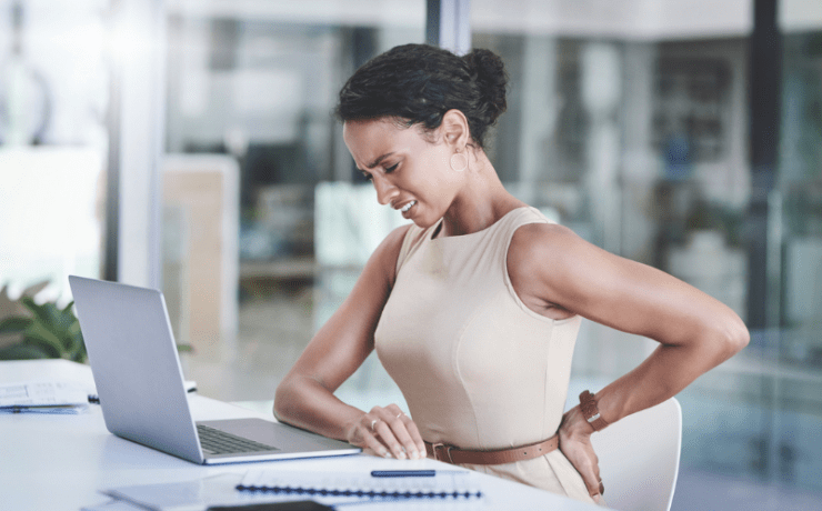 Woman at desk with back pain