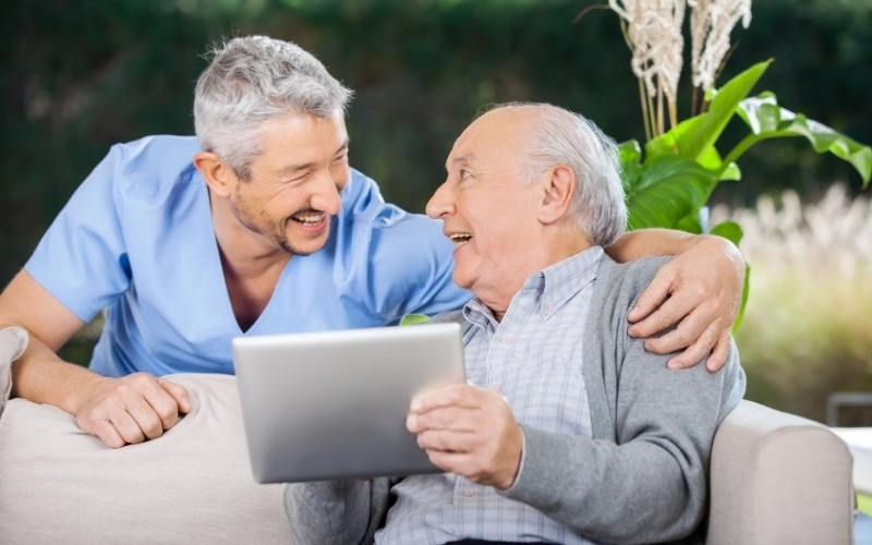 Two older men discuss men health myths on a tablet
