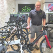 Photo of man and his electric bicycle.