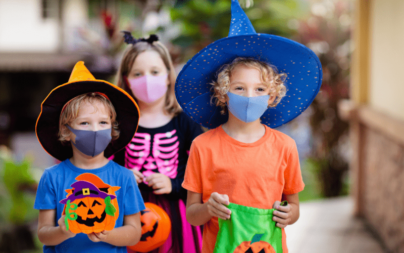 Kids with masks on Halloween
