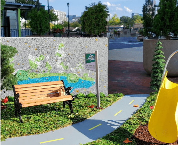 Tiny Parks with yellow slide and bench