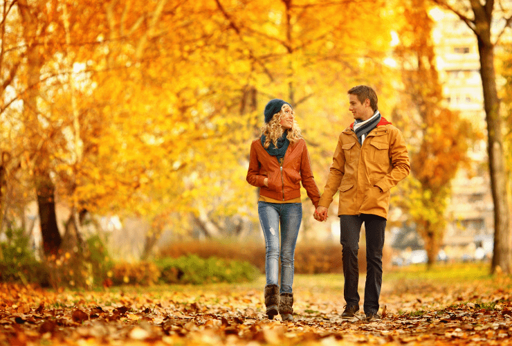 Couple walking in fall park